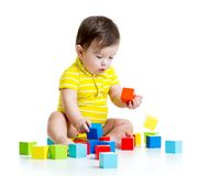 Baby boy playing with wood toys Stock Images