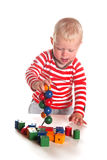 Baby boy is playing with wooden beads Royalty Free Stock Image