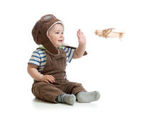 Baby boy playing with wooden plane. Child boy playing with wooden plane Royalty Free Stock Photography