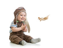 Baby boy playing with wooden plane royalty free stock photo