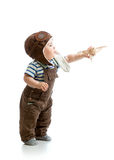 Baby boy playing with wooden plane. Kid boy playing with wooden plane Royalty Free Stock Photography