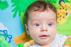 Baby boy on playmat Stock Image