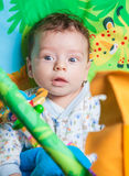 Baby boy on playmat Stock Photos
