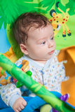 Baby boy on playmat Stock Photo