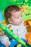 Baby boy on playmat Stock Photo