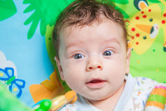 Baby boy on playmat Royalty Free Stock Photos