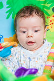 Baby boy on playmat Royalty Free Stock Image