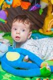 Baby boy on playmat Stock Image