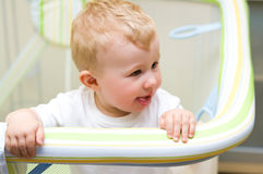 Baby boy in playpen Stock Photo
