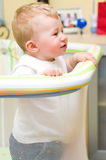 Baby boy in playpen. Baby boy standing in a playpen Royalty Free Stock Photography