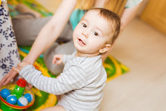 Baby boy plays in his room. Royalty Free Stock Photos