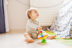 Baby boy plays in his room. Cute baby boy Stock Photos