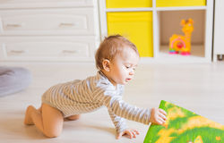 Baby boy plays in his room. Cute baby Royalty Free Stock Photography