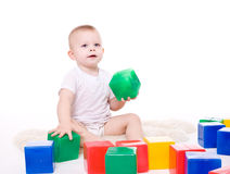Baby boy plays with toy blocks Royalty Free Stock Photos