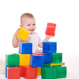 Baby boy plays with toy blocks Royalty Free Stock Photography