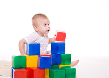Baby boy plays with toy blocks Stock Images