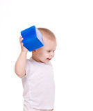 Baby boy plays with toy blocks Royalty Free Stock Image