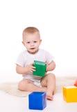 Baby boy plays with toy blocks Stock Photos