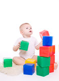Baby boy plays with toy blocks Stock Photo