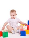 Baby boy plays with toy blocks Royalty Free Stock Images