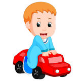 Baby Boy plays with a toy car Stock Photos