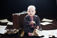 Baby boy plays with trumpet Royalty Free Stock Photography