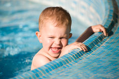 Baby Boy in pool Stock Images