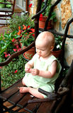Baby Boy on Porch. Baby boy on willow rocking chair on front porch of family home Royalty Free Stock Image