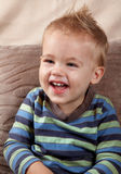 Baby boy portrait. Portrait of a little baby boy laughing outloud. Indoor shot Royalty Free Stock Photos