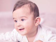 Baby boy. Portrait of giggling baby boy Stock Photos