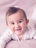 Baby boy. Portrait of giggling baby boy Royalty Free Stock Photo