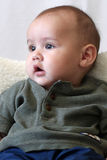 Baby boy portrait - vertical orientation. Vertically oriented portrait of an adorable four month old baby with big eyes.  He is looking toward the natural light Stock Photos