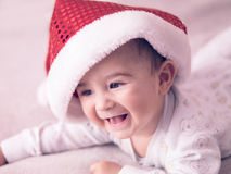 Baby boy. Portrait of a baby boy wearing Christmas hat Royalty Free Stock Photo