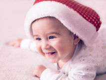 Baby boy. Portrait of a baby boy wearing Christmas hat Stock Image