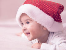 Baby boy. Portrait of a baby boy wearing Christmas hat Stock Photos