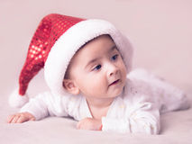 Baby boy. Portrait of a baby boy wearing Christmas hat Royalty Free Stock Photos