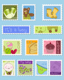 Baby Boy Postage Stamps. On blue Royalty Free Stock Photography