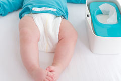 Baby boy preparing for a diaper change Royalty Free Stock Photography