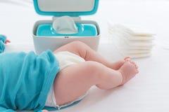 Baby boy preparing for a diaper change. Little baby boy preparing for a diaper change stock image