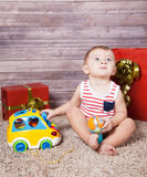 Baby boy with presents Royalty Free Stock Images