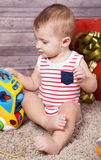 Baby boy with presents Royalty Free Stock Photography