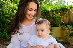 Baby boy and pretty young woman Royalty Free Stock Photos