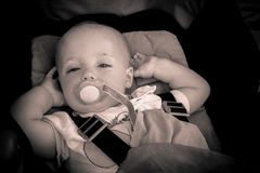 Baby boy in a pushchair Royalty Free Stock Photos