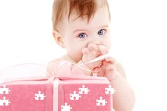 Baby boy with puzzle gift box Stock Image