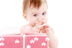 Baby boy with puzzle gift box Stock Photo