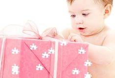 Baby boy with puzzle gift box Stock Photos