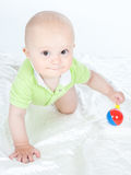 Baby boy with a rattle Royalty Free Stock Images