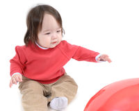 Baby boy reaching for toy Royalty Free Stock Photos