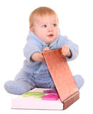 Baby boy read big red book. Royalty Free Stock Images