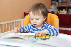Baby boy reading book Royalty Free Stock Image